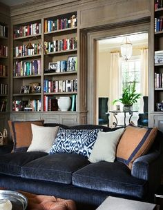 OK: I'm Currently Obsessed with Navy Velvet Sofas. But I think the grey stained (or dry brushed) paint ed bookshelves might be just the right way to tone down the white bookcases in the middle of the main room!
