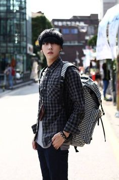 Korean model Park Hyung Seok wears a look favoring checked patterns. -Lily #streetstyle