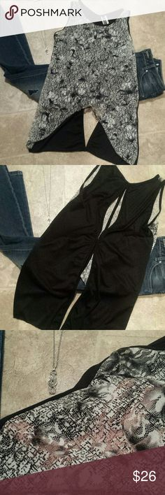 New Arrival Lace sheer front hi-lo open back tank Beautiful and sexy black and white tank with openings in the back for extra sex appeal. Front is see through.  Pair with a camisole, skinny jeans and black boots for a sexy date night outfit Tops Tank Tops