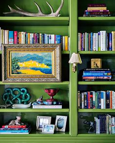 We're green with envy looking at this gorgeous bookshelf.  (: @brittanyambridge | Design: @kemble_interiors & @lindseyherod) #onstandsnow #HBshelfie #interiordesign #HBcolor