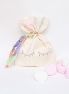These Calico bags are perfect for creating the cutest unicorn themed party favours for your party guests. Set of 10. Why not pop a long swirl lolly pop in each bag for the unicorns horn?!  *Hand stamped *10cm Wide x 16cm High  *Rainbow wool tie or hemp twine included for each bag. Please mention preference in notes to seller. All bags are made upon order. *Bags do not come with lolly pop.  Custom bag sizes are available. Please convo for any special requirements.