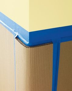 Walls are prone to bumps and dings, particularly at corners. Though you can't always avoid thwacking things into them, you can prevent damage by fashioning a bumper of sorts from corrugated cardboard, held in place with painters' tape.