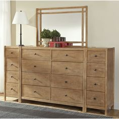 Bring natural beauty to your bedroom with this New Haven eight-drawer dresser. Crafted of sturdy plantation hardwoods with gorgeous knotty oak veneers, this lovely dresser set has plenty of storage space for your bedroom.