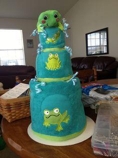 3 tier birthday towel cake themed frog. 2 bath towels, 2 hand towels, 2 washcloths, & a frog bath toy