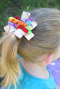 """Ribbon was on sale last week at my local craft store. Regardless of the fact that I already own 5 times the amount ribbon any one person should own, I suddenly felt the need to buy more! I found an adorable ribbon with rainbows on it, and knew I """"needed"""" to buy it for a …"""