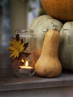 Blomsterverkstad: twine & leaves adorn a simple jar holding a tea light candle