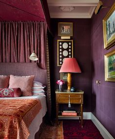 Layered fabric and pattern make for deep texture on the canopy bed | archdigest.com