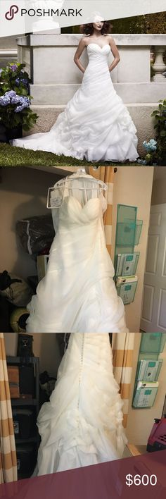 Casablanca wedding dress Delicately draped Organza gown has ruched bodice with a sweetheart neckline. Pick-ups on the skirt create the illusion of a rose motif. The back is accented with Crystal buttons. Fabric: Iridescent Organza Color: Ivory Casablanca Dresses Wedding