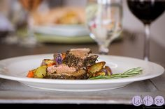 Herb-Crusted Pork Tenderloin with Roasted Root Vegetables & Purple Potatoes at Willowstone Catering #wedding #catering #entree #platedmeal