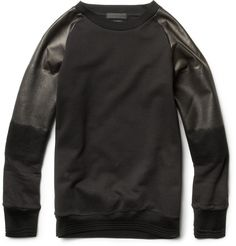 Alexander McQueen leather-sleeved cotton sweater.