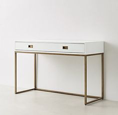 RH TEEN's Avalon Desk:The sleek lines of our collection exemplify the sophisticated restraint of modernism, while its polished cast-brass fittings – including recessed pulls and a metal base – take the composition in a stunning new direction.