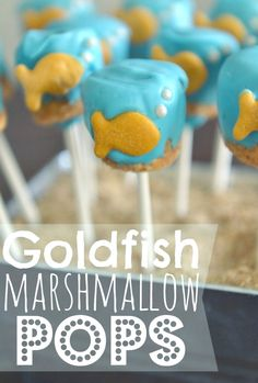 Goldfish Marshmallow Pops.  Such a cute idea for a goldfish, mermaid, or under-the-sea themed party. They look complicated but they actually come together in less than 30 minutes.  SO much easier than cake pops!