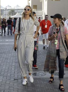 She's so ace: Maria Sharapova ditched her tennis whites as she showed off her ace figure in her pinstriped jumpsuit at Grand Prix in Abu Dhabi, United Arab Emirates on Saturday