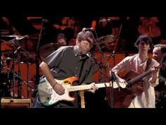 Eric Clapton -  While my guitar gently weeps (HQ)(Concert for George)    .... Pure Class .. and will always be my favourite song by George.