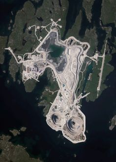 11/18/2015 Diavik Diamond Mine Northwest Territories, Canada 64.496111100°, -110.273333300°   The Diavik Diamond Mine is located on the Lac de Gras lake in the Northwest Territories of Canada, 120 miles (193km) south of the Arctic Circle. The mine produces approximately 7.5 million carats of diamonds each year. In standard weight, that's an annual output of 1500 kilograms or 3,300 pounds. In this Overview, the most distinguishable areas of the facility are its two primary open pits, waste…