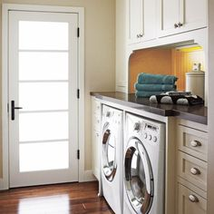 """This was the inspiration to open up the existing small laundry room and include it with the garage entry mud """"hallway""""."""