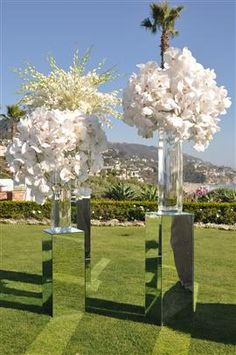 We had these mirrored bases that held our tall purple delphinium flower…
