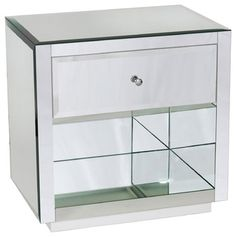 Sleek and shiny, this nightstand adds shimmering style to your modern boudoir. The reflective, mirrored glass has depth and dimension surrounding a storage
