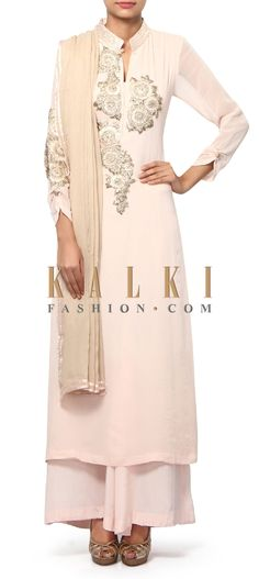Buy Online from the link below. We ship worldwide (Free Shipping over US$100). Product SKU - 312189.Product Link - http://www.kalkifashion.com/cream-pink-straight-suit-adorn-in-gotta-patti-lace-only-on-kalki.html