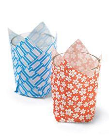 Origami Votive Wraps ~ Light shines through these thin paper sheaths, creating a gorgeous glow.  http://www.marthastewart.com/273319/origami-votive-wraps?czone=holiday/sixty-days-of-summer/party-ideas=276964=275330=273319