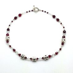 """Feel the Beat is a 16 """" sterling silver beads and Swarovski crystals in red and clear. Product # 1202037"""