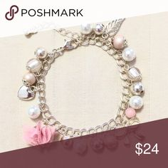 """Bow and Flower Charm Bracelet A cute, delicate charm bracelet with a ribbon charm, a fluffy flower charm, and a small silver heart charm. Antiqued finish.   Adjustable 6.5""""-8"""" length  ❌ Sorry, no trades. Jewelry Bracelets"""