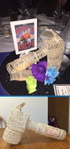 Unique Disney Wedding Centerpieces made by @jacquelinesander. DIY Disney characters made out of string. The Wreck-It Ralph table with Fix-It Felix's Hammer! Could also be great for Disney themed birthday. Made by @JacquelineFoss