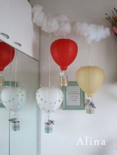 Hot air balloon lamps for the children's room. DIY: lamps are actually Ikea lamps that have been turned upside down. Used tin cans for the small stuffed toys