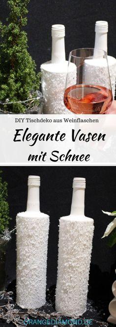 #anzeige Upcycling-DIY Elegente Tischdeko aus Weinflaschen: Winterliche Schneeva...