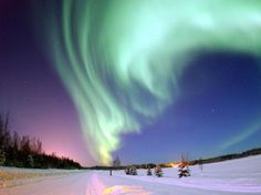 The aurora borealis, or northern lights, shines above Bear Lake on Eielson Air Force Base, Alaska Photo by Senior Airman Joshua Strang, U.S. Air Force (from Wikipedia).