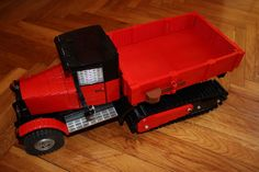 https://flic.kr/p/mYkJEt | ZiS 22M Halftruck | Last MOD of my ZiS 5 truck:  1:13 scale Features increased traction, new axle with turntables as joint points, and excellent suspension,  More to read and look: www.limitlessbricks.com/2014/03/zis-22m-halftrack.html  Follow me building on Facebook: www.facebook.com/LimitlessBricks  Check out my website: www.limitlessbricks.com/