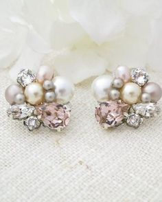 This blush asymmetrical earring has it all: a little bit of pearl and a little bit of sparkle! The unique placement of the pearls and rhinestones create an enchanting earring with modern appeal.... Pink Pearl Earrings, Cluster Earrings, Crystal Earrings, Pearl Studs, Pearl Necklace, Drop Earrings, Bridal Bracelet, Wedding Jewelry, Swarovski Jewelry