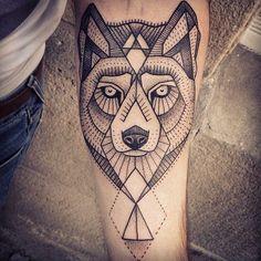 Black ink geometric wolf tattoo on arm