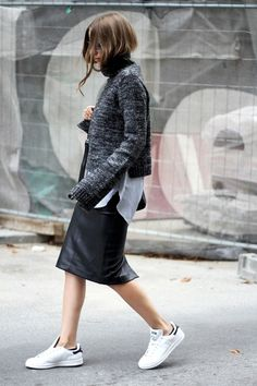 fall layers white sneakers addias sneakers black leather midi skirt pencil skirt sweater over shirt striped oxford shirt button up shirt grey sweater black scarf fall layers fall work outfit via fashion and style