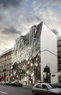 rh+ architecture // transformation of a former garage to media group headquarter, covered in a combination of photovoltaic and mirrored panels // Paris