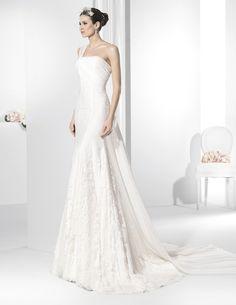 Vestidos de novia línea sirena con original cuerpo asimétrico.