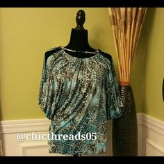 ***NEW*** Blue Top with Silver Neckline This Top is New & Never Worn. I purchased this item from Macy's. Tops Blouses