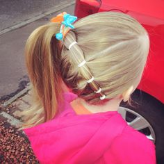 Little girls hair do.. Lots of elastics hold better than braiding !