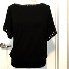 Black Ella Moss Top, Size XS Super cute black ella moss top with brass grommets around neck and sleeve.  Fitted waist band so can make a blouse like effect or pull down for a longer top to wear over leggings.  Adorable on!  Excellent used condition.  No stains or tears.  Pima cotton, modal, Lycra blend.  Soft and comfy Ella Moss Tops Blouses