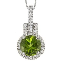 Add a stunning touch to your look with a diamond and peridot pendant Eye-catching necklace is crafted of white gold Jewelry features a beautiful peridot stone surrounded by 36 dazzling diamon Peridot Jewelry, Peridot Necklace, Gemstone Necklace, Gold Necklace, Pendant Necklace, Cute Jewelry, Gold Jewelry, Jewellery Box, Jewelry Necklaces