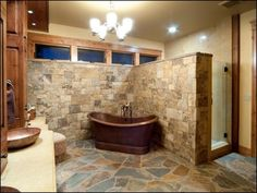 Bathroom, Antique Bathtub Stand On Natural Slice Rocks As Flooring Also Decorating Divider In This Rustic Bathroom: Oldschool Rustic Bathroo...