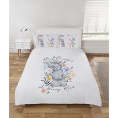 Fans of Tatty Teddy will love this officially licensed Me To You duvet set featuring the the loveable grey bear with a blue nose & patches, on a white ground surrounded by flowers, with the reverse featuring an all over smaller design.