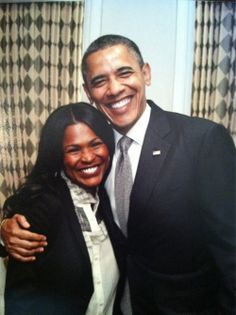 Nia Long posing with President Obama