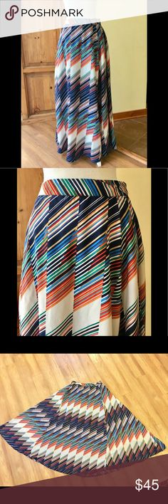 Multicolor Diagonal Stripe Maxi Skirt Stunning diagonal multicolor stripe maxi skirt, maker unknown as previous owner removed tags. The colors are brilliant, the material is NOT sheer, feels like silk but could be polyester. Measurements lying flat: waist 15 inches, length 41 inches. Skirt is lined, lining goes from waist down 20 inches. A lovely and dramatic skirt! Skirts Maxi