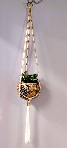 Terrific Photographs Handcrafted Unique Gold and White Macrame Plant Hanger / Other colors available ~~~ Free Ship Concepts When there is little space for the keeping of flowerpots, hanging flowerpots are a great Alternative Macrame Hanging Planter, Hanging Flower Pots, Macrame Plant Holder, Flower Planters, Plant Holders, Hanging Planters, Little Flowers, All Flowers, Big Plants