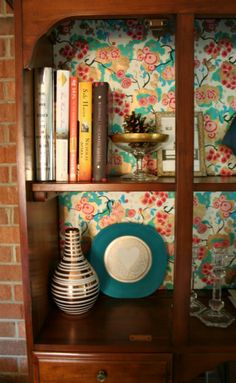 Line books in a china cabinet to make it personal and functional (if you aren't a fine china person). | www.rappsodyinrooms.com