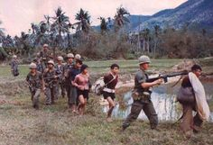 U.S troops with four Vietnamese suspected of either being or collaborating with the Viet Cong. ~ Vietnam War