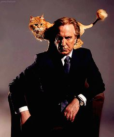 →Alan Rickman photoshoot by Stuart Hendry --- All men should be photographed with kitties.