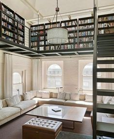 upstairs - could do tall built ins art display with library ladder that goes around to the loft opening