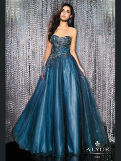 This lovely pageant gown will make you a fairy princess on your pageant. This tulle and beaded embroidery black label dress by Alyce 5556 features a sweetheart neckline, ruched bodice, and gorgeous beading and embroidery on the fitted bodice. A ball gown skirt completes this look. Shawl included. This pageant dress is available only in navy/turquoise. Wear this stunning pageant dress for a look to be remembered for your special event.